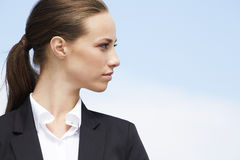 Young businesswoman. Looking away against blue sky royalty free stock photography
