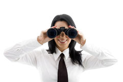 Young businesswoman looking through binocular Stock Photos