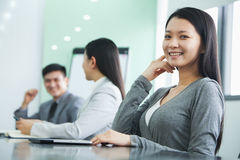 Young Businesswoman Looking At Camera in a Meeting Stock Photography