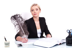 Young businesswoman looking into camera on white background. Royalty Free Stock Photos