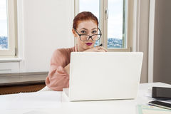 Young Businesswoman Looking at Computer Seriously Royalty Free Stock Photo