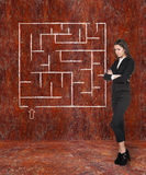 Young businesswoman looking at the labyrinth Royalty Free Stock Image