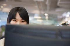 Young Businesswoman Looking over Computer in the Office Stock Images