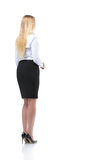 Young businesswoman looking at something. Back view Stock Photos