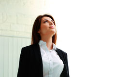 Young businesswoman looking up at copyspace Stock Photos