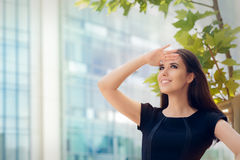 Young Businesswoman Looking Up  and Searching for Something Royalty Free Stock Images