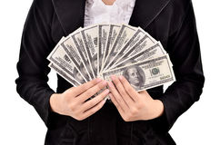 Young businesswoman with lots of dollars in hands Stock Photo