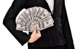 Young businesswoman with lots of dollars in hands Royalty Free Stock Image