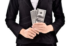 Young businesswoman with lots of dollars in hands Stock Image