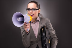 The young businesswoman with loudspeaker in business concept. Young businesswoman with loudspeaker in business concept Stock Photos