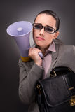 The young businesswoman with loudspeaker in business concept. Young businesswoman with loudspeaker in business concept Stock Image