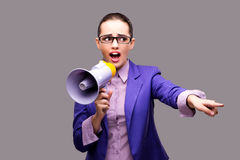 The young businesswoman with loudspeaker on gray background. Young businesswoman with loudspeaker on gray background Stock Photos