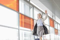 Young businesswoman with luggage running in railroad station Royalty Free Stock Images