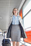 Young businesswoman with luggage walking in railroad station Stock Image