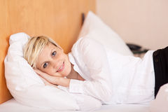 Young Businesswoman Lying On Bed Stock Photos