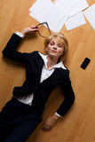 Young businesswoman lying on floor. Beautiful blonde young businesswoman lying on floor Stock Photos
