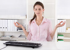 Young businesswoman making a break in the office and meditate. Stock Photography