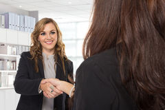 Young businesswoman making a deal Stock Image