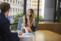 Young businesswoman and man talking at an informal meeting. Young businesswoman and men talking at an informal meeting stock photo