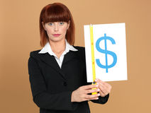 Young businesswoman measuring dollar sign Stock Photography