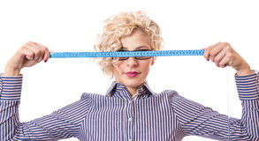 Young businesswoman with measurnig tape Stock Photography