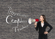 Young businesswoman with megaphone Royalty Free Stock Image
