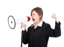 Young businesswoman with megaphone, screaming Royalty Free Stock Photos