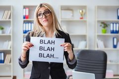 The young businesswoman with message in the office Stock Images