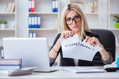 The young businesswoman with message in the office Stock Image
