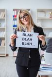The young businesswoman with message in the office Royalty Free Stock Photos