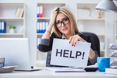 The young businesswoman with message in the office Stock Photo