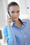 Young businesswoman with mobile phone Stock Photo