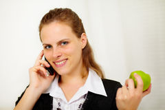 Young businesswoman at mobile phone Stock Images
