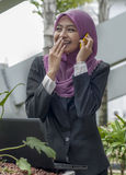 A young businesswoman. With mobile phone Royalty Free Stock Image