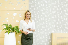 Young businesswoman with mobile phone Royalty Free Stock Photos