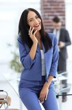 Young businesswoman with mobilephone Stock Images