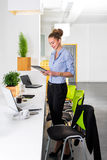 Young businesswoman in modern bright office holding the tablet with a list of tasks. Business concept of office work. Young businesswoman in modern bright stock photo