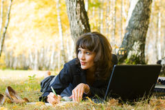 Young fashion business woman with laptop working outdoor Royalty Free Stock Images