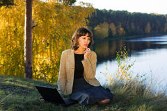 Young businesswoman on nature. Stock Image