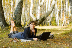 Young businesswoman on nature. Stock Photography