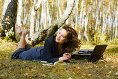 Young businesswoman on nature. Royalty Free Stock Photo