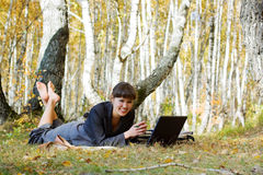 Young businesswoman on nature. Stock Photo