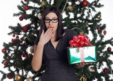 Young businesswoman near new year tree with present Royalty Free Stock Photo