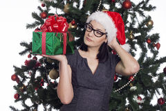 Young businesswoman near new year tree with present Royalty Free Stock Photos