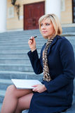 Young businesswoman with notebook. Stock Photo