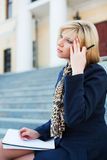 Young businesswoman with notebook. Royalty Free Stock Photography