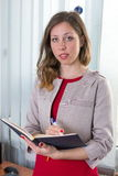 Young businesswoman with notebook Stock Photography