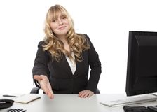 Young businesswoman offering her hand Royalty Free Stock Photography