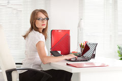 Young businesswoman  at the office. Royalty Free Stock Image