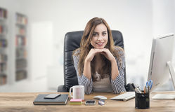 Young businesswoman in office Royalty Free Stock Image